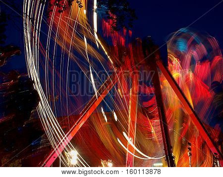 Carousel. Lodz, Poland - May 24, 2011 Blurred motion circular carousel during the evening festivities at the mall Manufactory in Lodz.