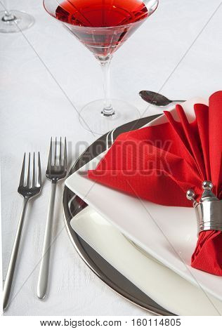 Festive Christmas or wedding table with red napkins on a white tablecloth