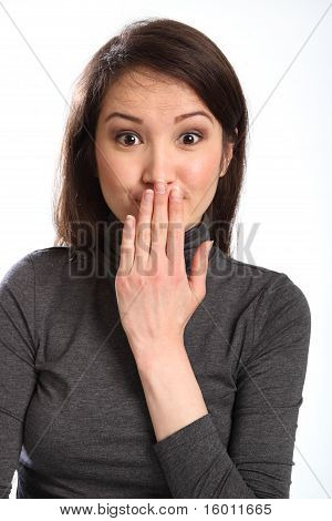 Oops woman with hand over mouth