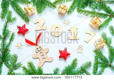 New Year 2017 background with 2017 figures Christmas toys fir branches-New Year 2017 still life. Concept of Happy New Year 2017 holiday with New Year objects. Flat lay top view vintage tones