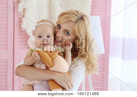 Happy mother with daughter in room
