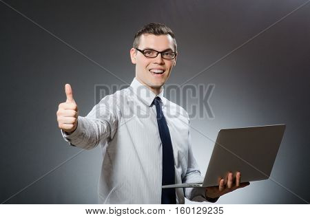Man with laptop and thumbs up