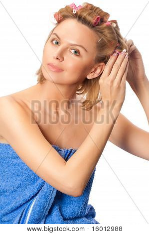 Portrait Of Young Beautiful Woman In Towel Making Hairstyle With Curlers