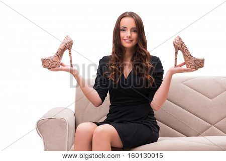 Woman having difficult choice between shoes