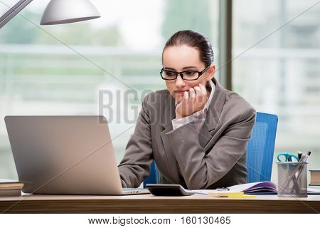 Sad businesswoman working at her desk