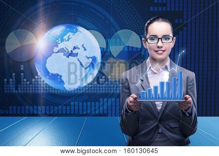 Businesswoman in stock trading business concept