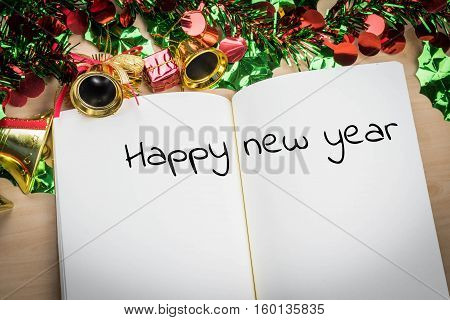 Happy New Year Word On Notebook With New Year Decoration For New Year Holiday