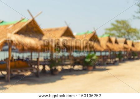 Blurred image of waterfront restaurant at travel place.