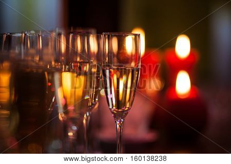 A lot of wine glasses with a cool delicious champagne or white wine at the bar