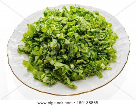 Dish with fresh chopped greenery.	Porcelain plate with gold edges, filled with chopped greens. Prepared especially for soup or salad.