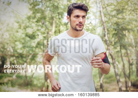 Athletic young sportsman with handband running in forest in the morning. Do your workout everyday