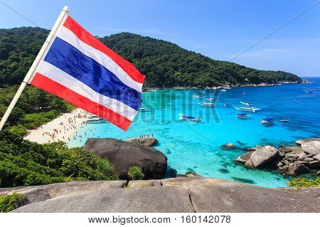 Travel concept Tropical beach beautiful sea and blue sky at Similan island with thai flag foreground Andaman sea Thailand