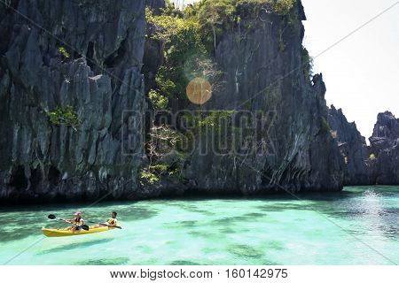 El Nido Palawan in the Philippines - May 19 2007: tourists kayaking through the costal karst lagoons - EL Nido is ranked as one of the best travel destinations in the world winning many travel awards
