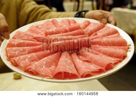 BEIJING - FEBRUARY 24: Mutton prepared for cooking in the hot pot, in Beijing, China, February 24, 2016.