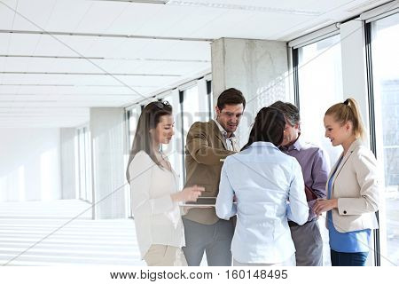Business people having discussion in empty office