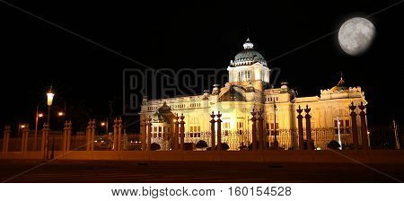 beautiful landscape Ananta Samakhom Throne Hall Royal Palace at night with full moon and copy space for text