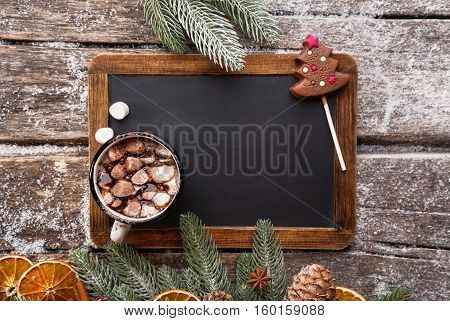 Christmas Background with Hot Chocolate and Black Chalk Board, top view. Lots of copy space