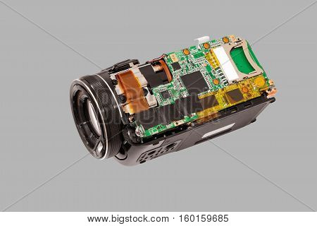 Disassembled compact camcorder. Close-up. Isolated on a gray background.