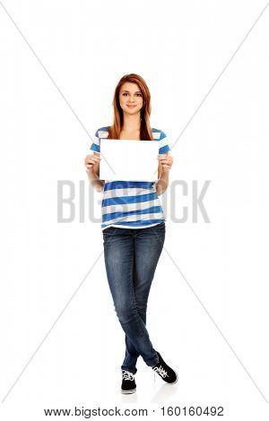 Teenage woman holding blank card
