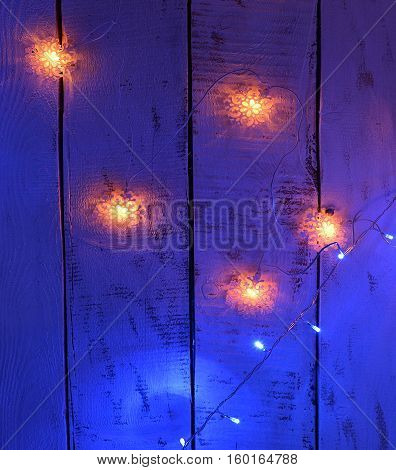 Snowflake lights on blue background. New Year and Christmas concept