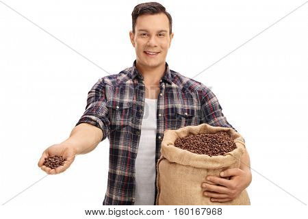 Happy farmer offering coffee beans from a burlap sack isolated on white background
