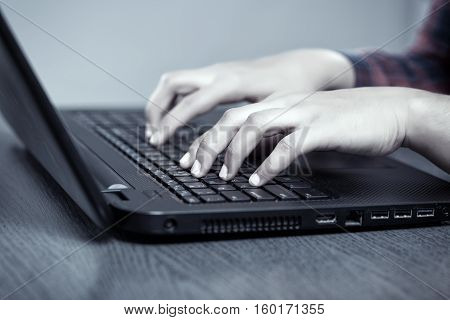 Hands Of A Woman Typing On Laptop