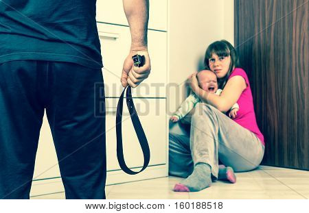 Man With A Belt Is Abusing His Wife And Baby - Domestic Violence