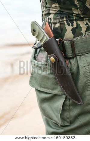 war zone. military knife. armed man. military concept.
