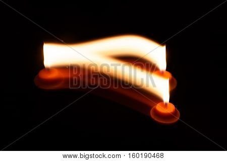 abstract yellow candle isolation on black background photo