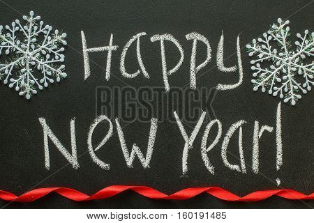 Happy New Year message greeting handwriting on a blackboard