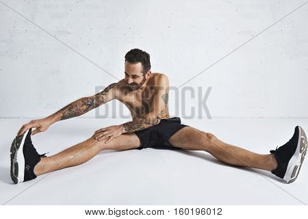 Stretching Fitness Routine In White Room