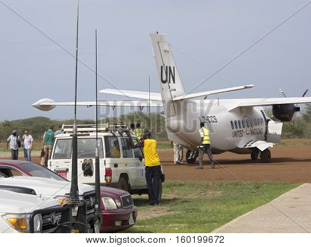 BOR, SOUTH SUDAN-JUNE 26, 2012: Workers load a UN plane with food aid in South Sudan