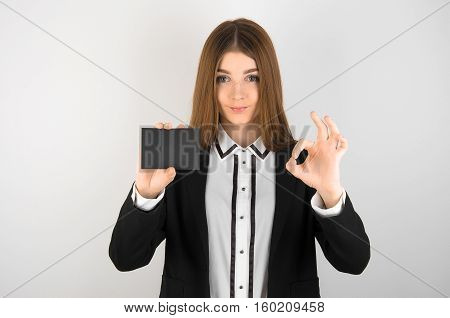 Business And Discounts Topic: Beautiful Young Girl With Freckles In A Black Jacket And White Shirt H