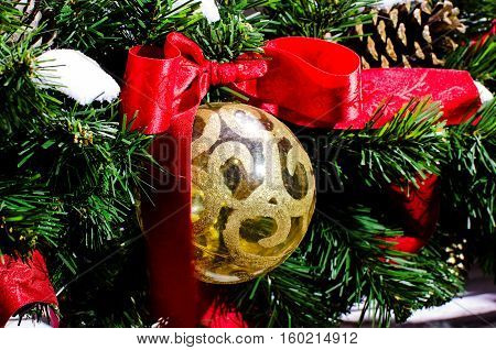 Christmas tree toy. Decoration festive pine. Ball with a bow. New Year