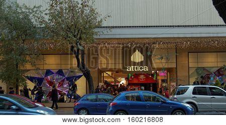 Thessaloniki, Greece - December 03 2016. Attica mall Christmas showcase. People at the decorated Christmas facade of Attica fashion center  at Tsimiski street Thessaloniki.