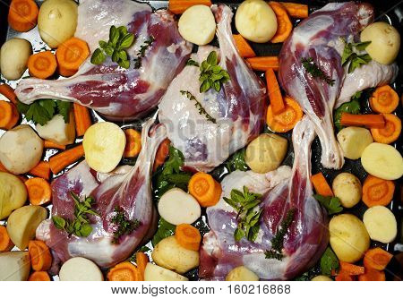 Duck legs and vegetables ready for baking