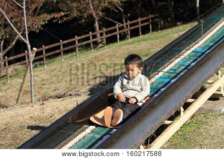 Japanese boy on the slide (3 years old)