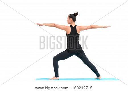 Beautiful Asian woman practicing yoga pose on white background
