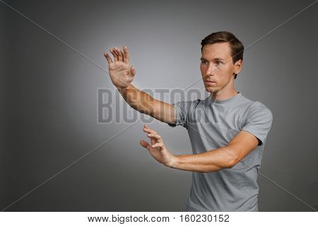 Man working with transparent virtual interface screen.