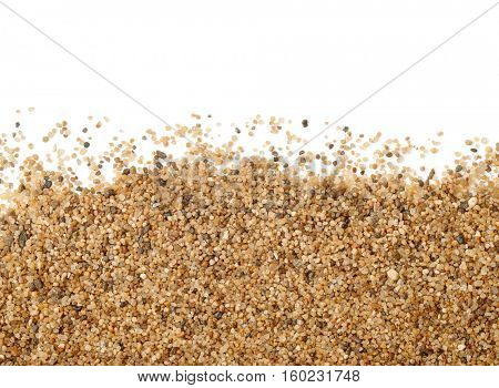 Close up of sand scattering on white background