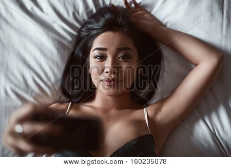 Portrait Of A Beautiful Sensual Asian Woman With Phone