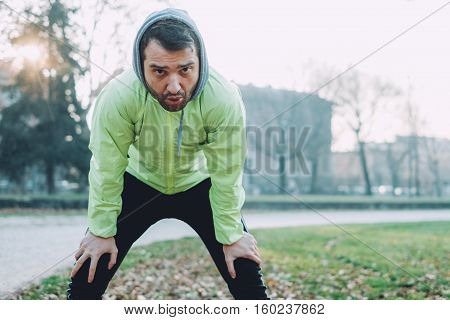 Man Working Out In The City Park In Cold Weather