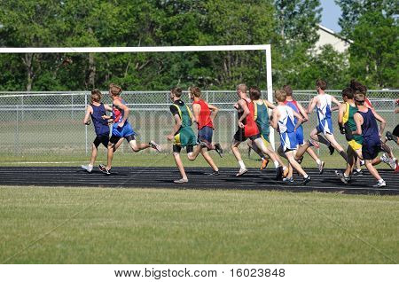 Teen Boys Running In A Long Distance High School Track Meet Race