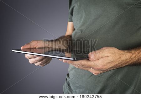 Male hand holding a modern tablet. Business technology internet and networking concept.