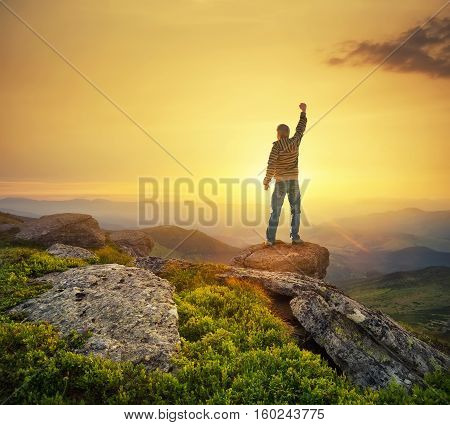 Silhouette of a champion on mountain peak. Active life concept