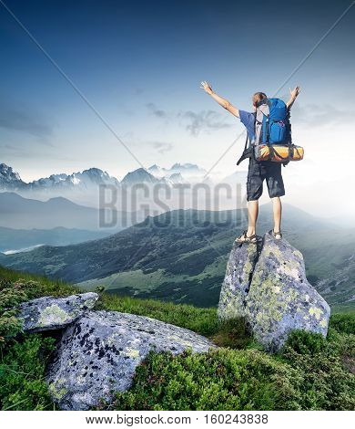 Tourist on top of high peak. Sport and active life concept