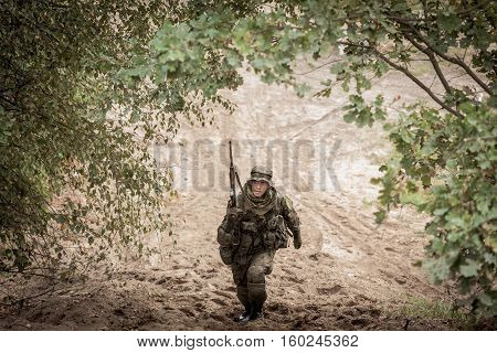 Soldier With Weapon In Uniform