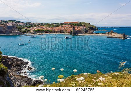Tourists enjoy the beach of Collioure coastal village in the south of France Mediterranean sea Languedoc Roussillon Pyrenees Orientales