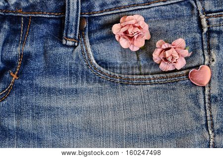 on jeans background laid roses and hearts. Backgrounds Valentine's Day. Wedding background. love card. pocket jeans