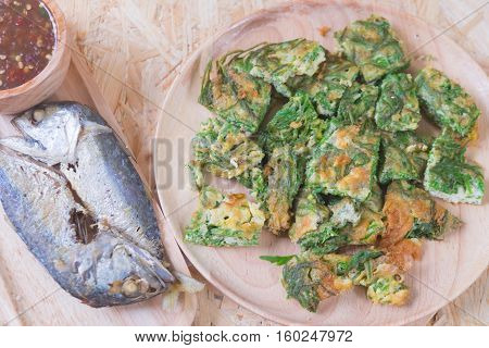 Thai local popular food as spicy shrimp paste dip served with fried acacia pennata omelet and fired mackarels